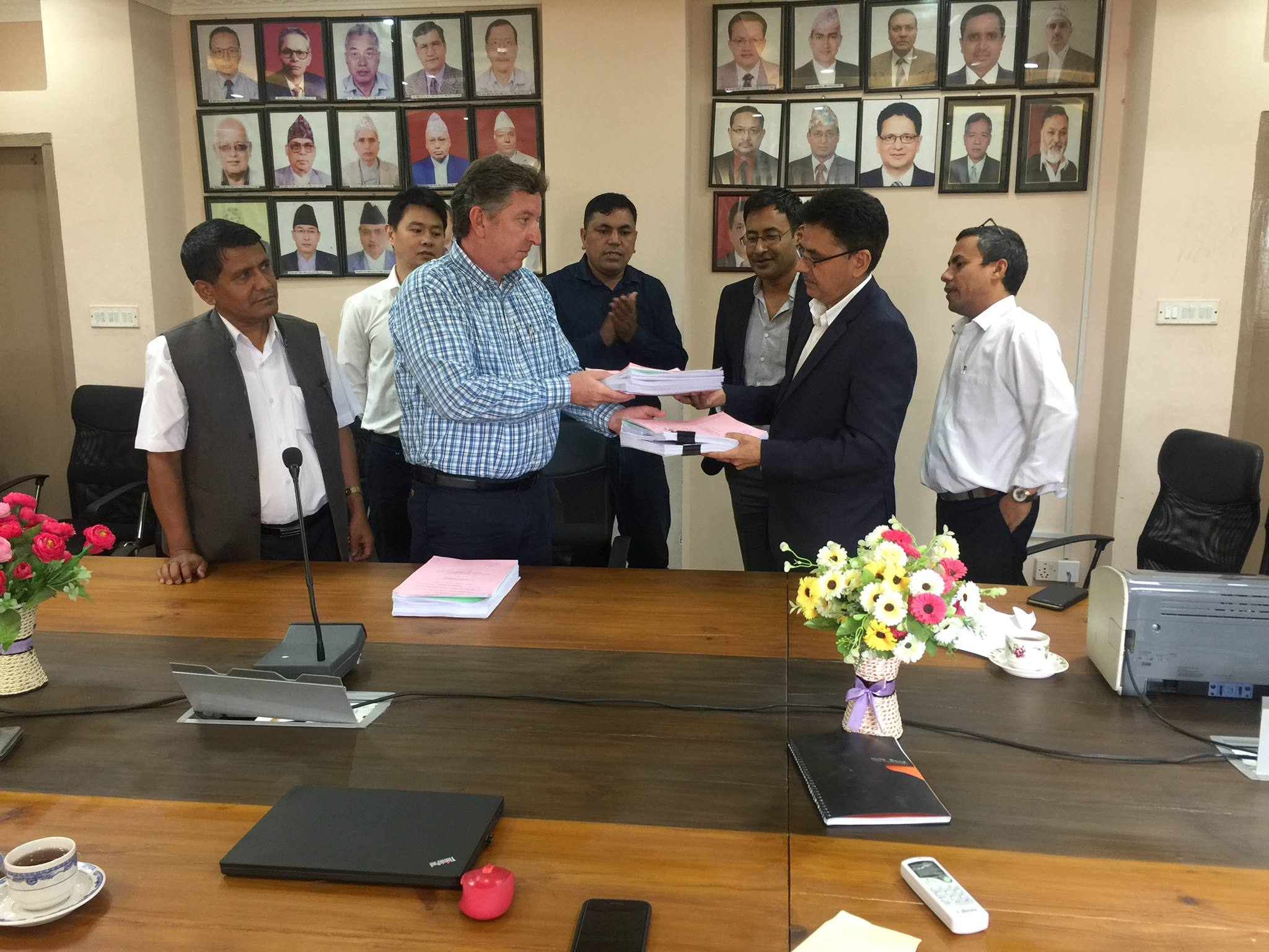 Dr. Beau Freeman of Lahmeyer signs the contract documents with Madhav Belbase, Joint Secretary of the WECS