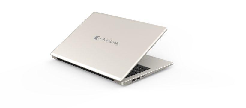 Ein Notebook mit silber-goldenem Gehäuse, es ist fast zugeklappt, die hintere Seite schaut nach vorne